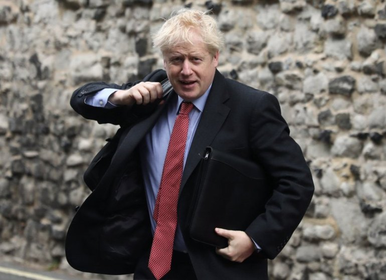 Boris Johnson, a leadership candidate for Britain's Conservative Party, arrives at offices in central in London